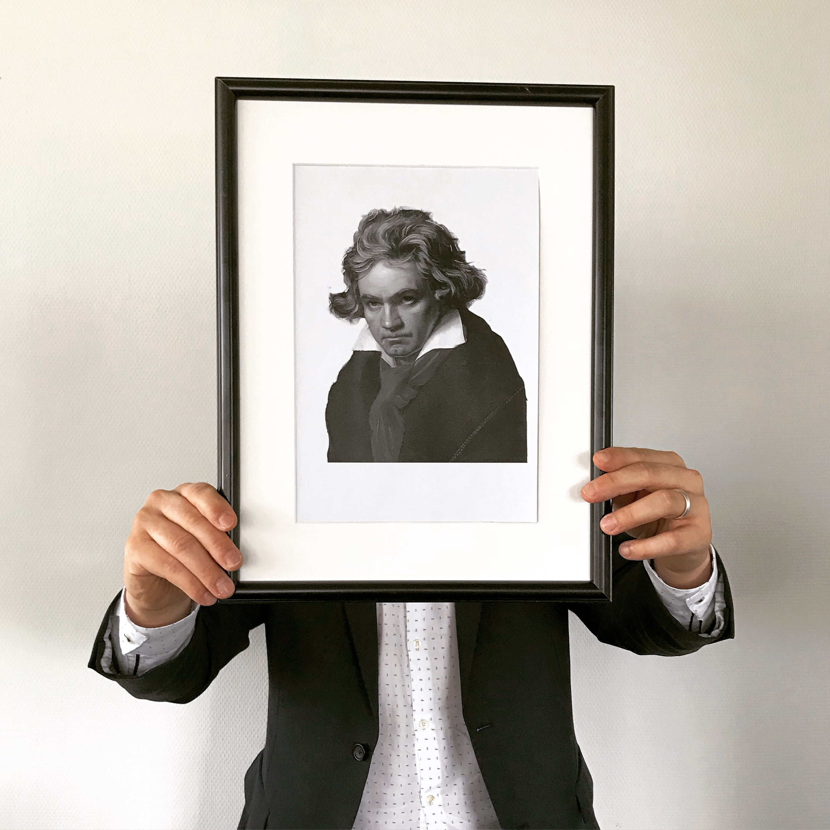 man holding Beethoven portrait
