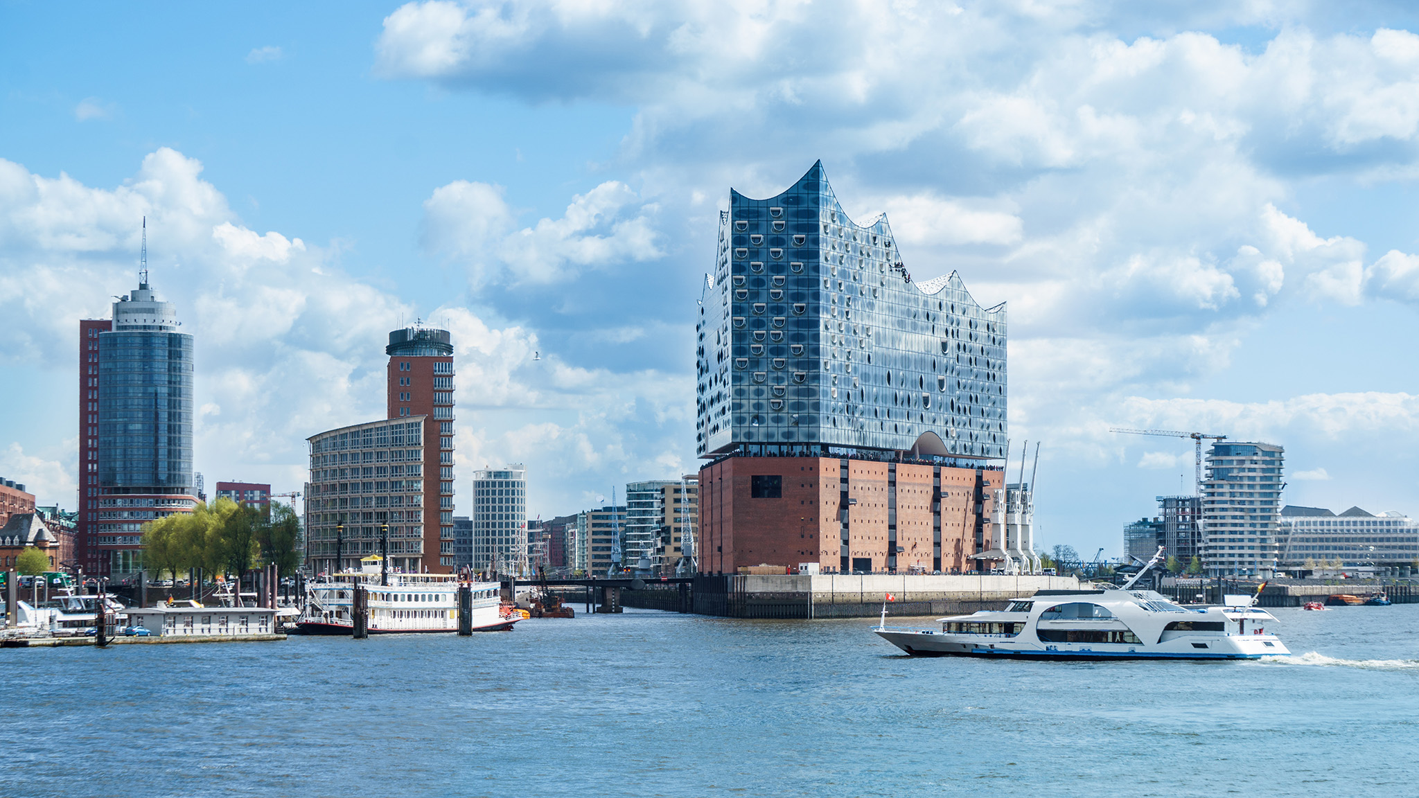 Hamburg, elbphilharmonie and modern buildings with boat to the harbor tour; Shutterstock ID 641329339